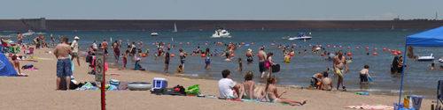 The Chatfield swim beach is heavily used on a recent Sunday afternon.