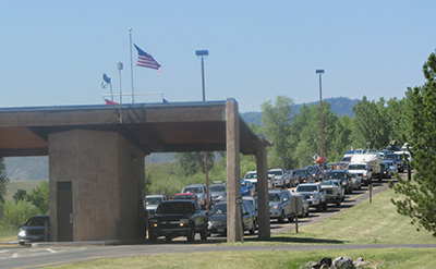 Cars at a park enterance station.