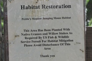 Sign advising about habitat restoration.